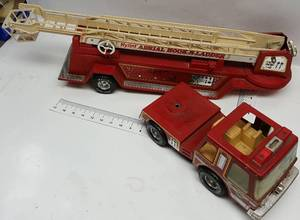 Another in a little nicer condition Nylint Hook-N-Ladder fire truck