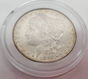 1891S Morgan silver dollar in display