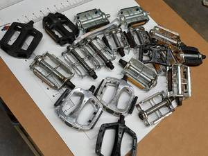 Box of exotic to bicycle pedals in different shapes and sizes