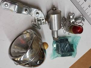 Bicycle generator and pieces of a headlight for your parts stash