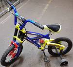 Kids trick bike with 14 inch tires and dual shock suspension